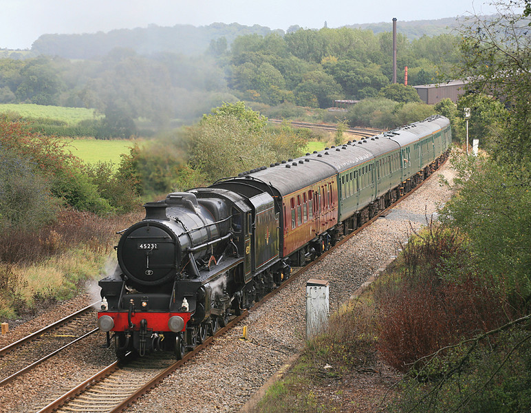 Black 5 no 45231 at Witham, Somerset, on 30 September 2006 with a Victoria to Minehead charter.  This was taken with a long lens from the Bunn's Lane overbridge.  The chimney behind the train has since been dismantled.