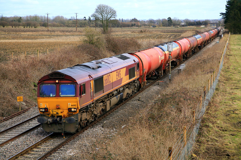 66012 at Manningford Bruce with diverted Theale to Margam empty fuel tanks (6B33) on St Valentine's Day, 2009.