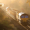 The low sun glints on 66107 on the rear of the train in the previous picture, which is about to pass an 'up' HST near Witham Friary.  03/12/11.