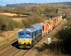 In superb winter sun, 59002 approaches Witham Friary with  6W35, a High Output Ballast Cleaner (HOBC) set from Westbury to East Somerset Junction for work on the Merehead Branch at Wanstrow.  25/02/12.