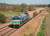 WOODBOROUGH.  59005 at Woodborough with 7C77, 14:25 Acton to Westbury MRL stone wagons on 17 April, 2010.