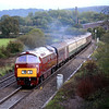 D1015 'Western Champion', recently repainted in BR maroon, passes Bunns Lane on the  approach to Witham Friary on 21 October, 2006.