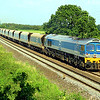 59002 'Alan J Day' at Berkley Marsh with 7C77, 12:40 Acton to Merehead empties.  26/07/12.