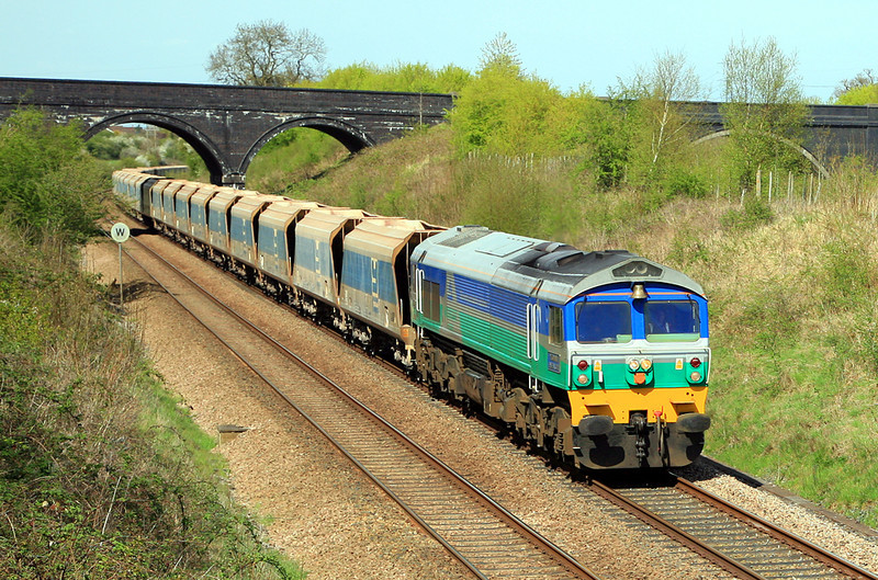 59001, displaying its brass bell, passes Styles Hill with 7C77, Acton to Merehead empties on 26 April, 2010.  The broader arch on the right carries the A362 over the modern A361 Frome by-pass.