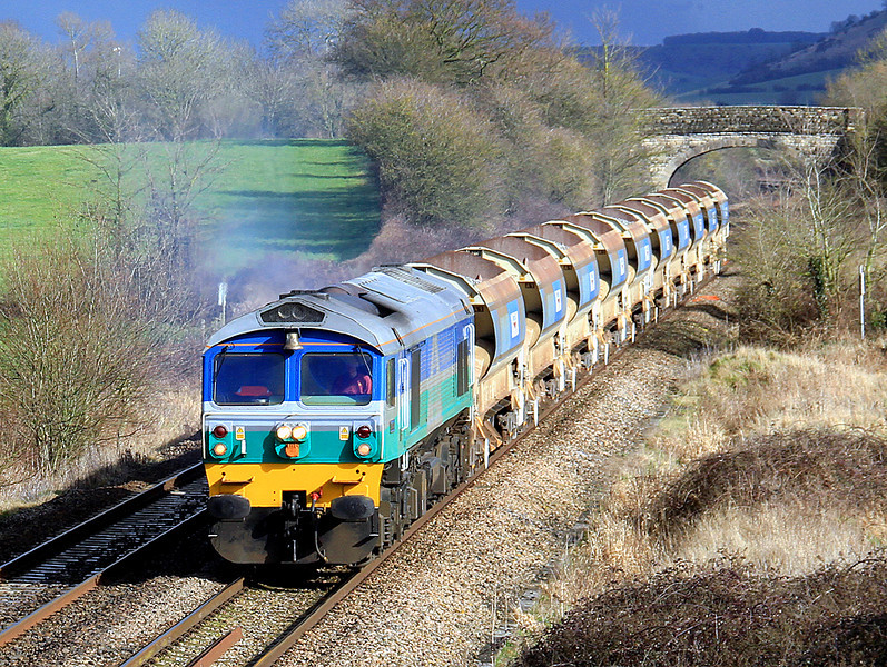 With its brass bell shining in the sub, 59001 pulls away from Westbury with 'autoballasters' for the East Somerset Branch. 3/03/12.