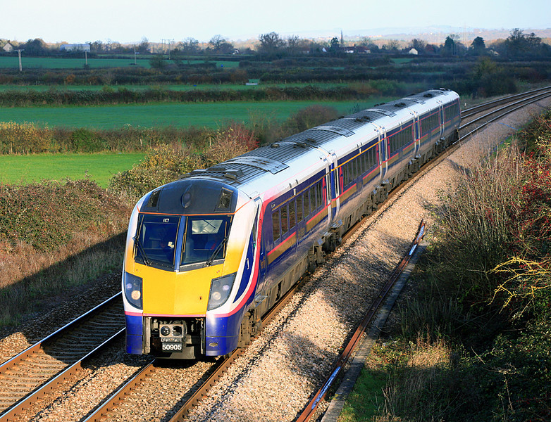 Lost train; lost location.  A Class 180 'Adelante' set, no longer used by First Great Western, heads at Berkley Marsh, a location since ruined by the erection of an ugly communication tower that obscures the view from the south side of the line. 23/11/06.