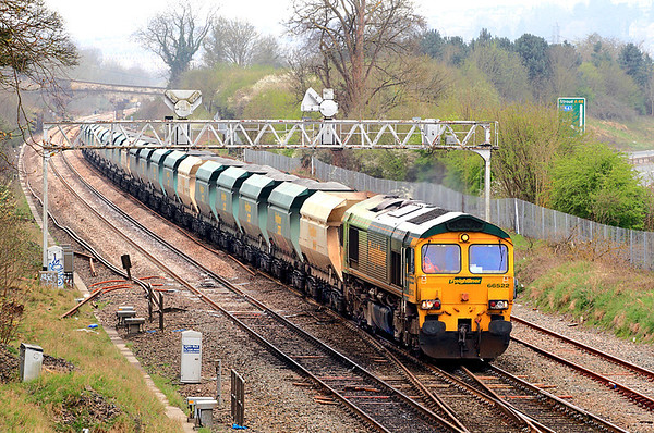 Shanks/FLHH-liveried 66522 crawls away from a check at Bathampton with 6A21, Pengam to Theale stone products.  31/03/12.