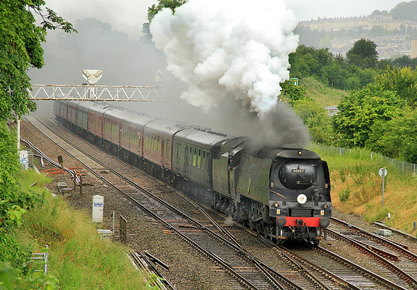 34067 'Tangmere' blows off as it approaches Bathampton Junction on 1 July 2012 with the season's inaugural 'Weymouth Seaside Express'.  Cool, wet, conditions can make steam look quite spectacular.