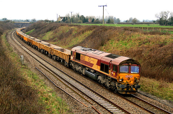 Back from France and still carrying European livery, 66033 passes Thingley with an engineers' working bound for Hinksey near Oxford.  The junction for the line to Melksham and Trowbridge is about a quarter of a mile ahead of the train but is not easy to photograph.