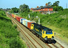 70007 passes Chipping Sodbury at speed with a Wentloog to Southampton 'liner' on 10 August, 2012.
