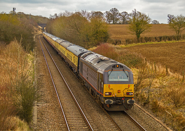 67005 'Queen's Messenger' speeds past Pig Lane, Farleaze on 23 February 2013 with UK Railtours' 'Welsh Marches Panorama' tour from Stevenage to Hereford.  Despite losing over 30 minutes due to an unscheduled fuel stop at Didcot, the train reached Hereford five minutes early!