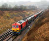 60091 at Chipping Sodbury in eavy rain with 6B33, 12:12 Theale to Margam empty fuel tanks.  18/02/12.