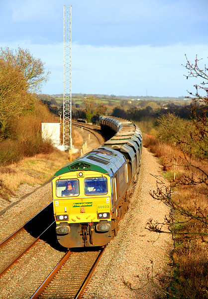 66623 at Rodbourne Bottom with 6V60, the Angerstein to Stoke Gifford aggregates working.  26/02/11.