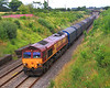 66092 at Alderton with 6Z12, Dollands Moor-Llanwern steel wagons on 16 July, 2011.  This was taken from an occupation bridge a short distance from the Fosseway road, visible behind the rear wagon.  Cut back by Network Rail in 2010, shrubs and trees are already starting to onbscure the view.