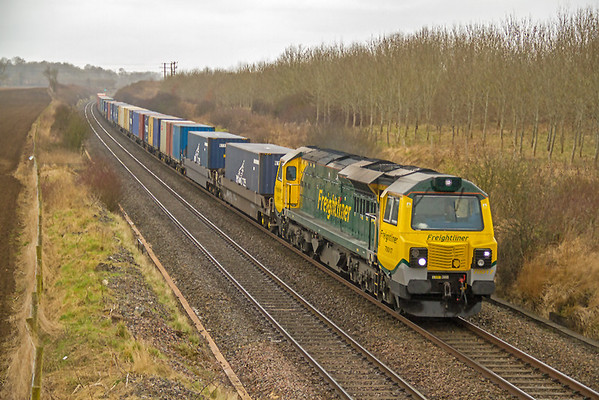 70017 approaches Pig Lane bridge, Farleaze, with 4O51, 09:58 Wentloog - Southampton containers.  01/03/2013.