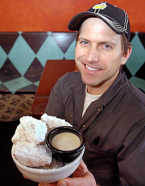 . Roux Dat owner Chad Glassley presents a deep dish of Beignets at his Cajun restaurant in Capitola.  (Dan Coyro -- Santa Cruz Sentinel)