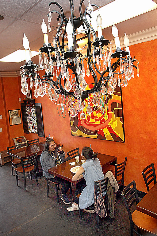 . Cut glass chandeliers and wildly hot colors set the scene at Rouk Dat in Capitola.  (Dan Coyro -- Santa Cruz Sentinel)
