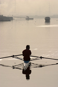 A single sculler on the creek.