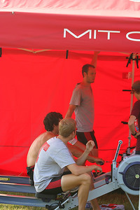 Stretching and erging in the bright red MIT tent with the most ferocious looking beaver on it.