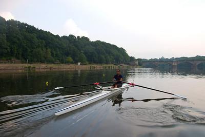 Aisha rowing towards the finish.