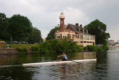 """Kiran rowing past the """"Lighthouse"""".  At this point you have to row light so that wakes do not disturb the boats."""