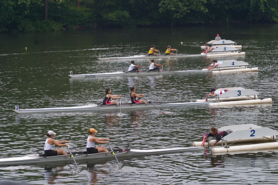And the crews start.  I caught the first few strokes.  The boats start with a stagger, with lane 6 farthest behind and line 1 ahead.  This is because of the dog leg turn in the course at Strawberry Mansion bridge.