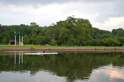 """Aisha rowing past the """"Angels"""", another landmark on the river where angel statues on posts are pegged by the river."""