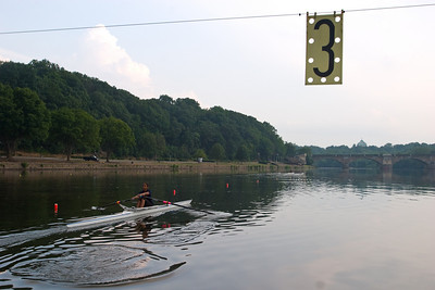 """Going under the """"wire"""".  This is where the lane numbers are stretched out over the water at the 1600 meter mark."""