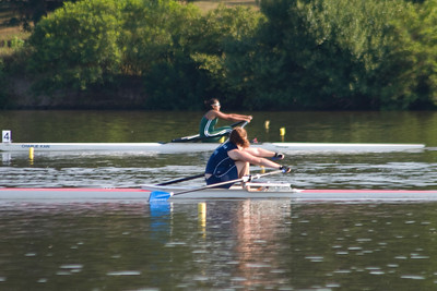 In the last 5 strokes the sculler close to the camera moved ahead but she still finished third.