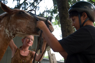 Putting on the bridle.