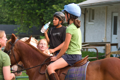 After riding in the ring, Anisa and Sabir got a drink and then left for a trail ride in the forest.