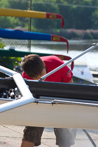 Sabir gets to wash the boat to speed up the process.