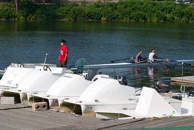The girls double comes back to the dock.