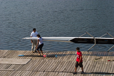 The new way of carrying the boat and the oars at the same time.