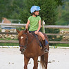 Anisa riding around the ring.