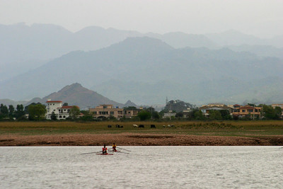 Rawal Lake in March 2006.  The water level is very low.  Once of the mansions in the back is said to belong to Dr. A. K. Khan!