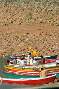 Row boats lining the shore.