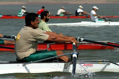 Maqbool bending the oar.