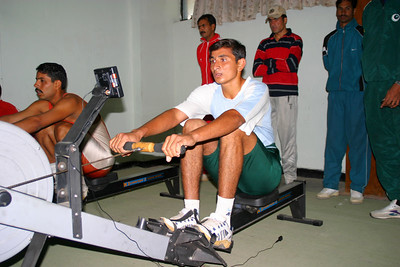The first erg test for 2K left a lot of athletes gasping for breath.  They had just returned from a break for Eid for about a week or ten days and were very out of shape.  One of the Navy rowers in the foregound.