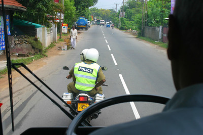 """Everywhere we went we had the police motorcycle in front clearing the way and a police jeep in the back as well as soldiers inside the bus.  The driver played the game of """"lets get as close to the motorcycle and make the guy turn around!"""" .  Everytime the rider turned around the driver and the conductor would burst out laughing because they scared him."""