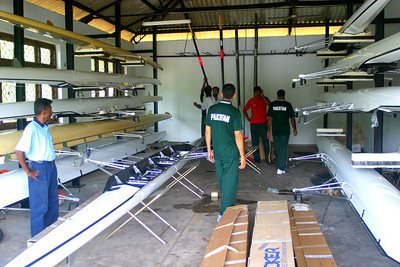 After a few days I finally convinced them to let us at least rig the boats.  They had been stored only a mile from the race course at the University boathouse.