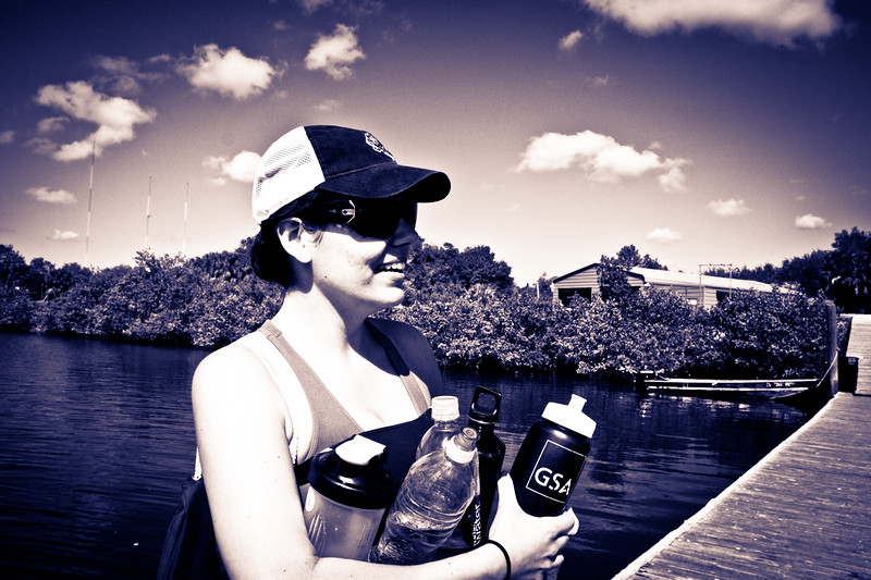 Coxswain holding all the guys waters.  Have to stay hydrated in florida.