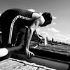 undoing the oarlock to get the oar out