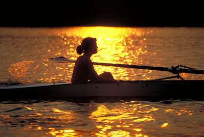 Sarah in the sunset.  Another favourite of mine. You can see the water coming off the oar.