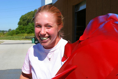 Meg after we took away the red paint from her.  That reddish glow in her air and her face is no reflection from the oar!  She really was covered by paint.
