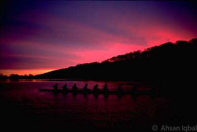 Junior Girl's 8 at sunrise at Creve Coeur Lake. 1998.