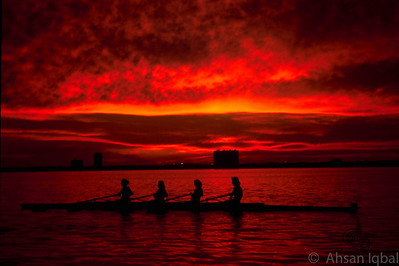 Junior Women's 4 from St. Louis Rowing Club in Tampa, Florida at sunset.  This is an untouched photograph.