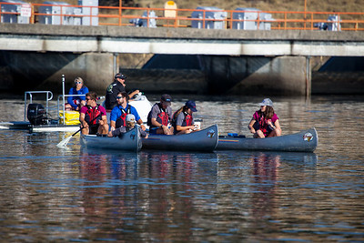 Water carriers in canoes who brought water bottles to the crews as they crossed the finish line.