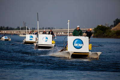 Wave generators for pushing debris off the course.  The launches went back and forth moving the small wooden sticks and debris by a few feet every pass.