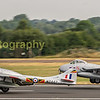 The civilian registered and Norwegian owned ex RAF Vampires depart